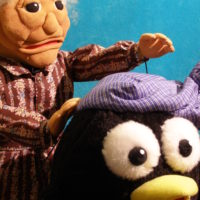 Anciana y pingüino